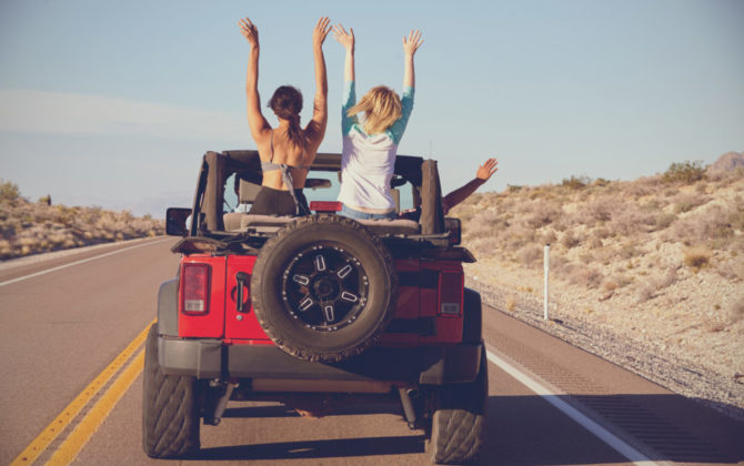 a jeep driving with two girls sitting in the backseat discussing student loan refinance misconceptions