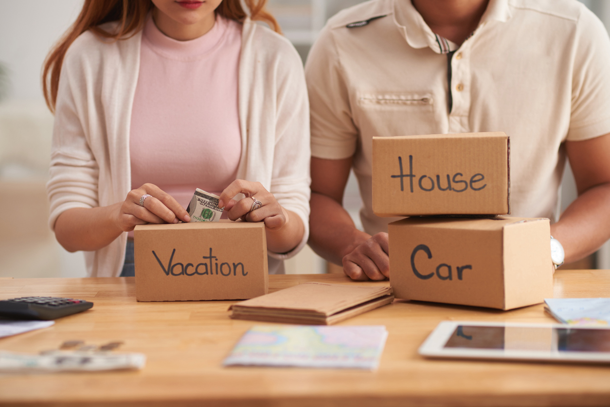 couple saving cash in the vacation box, mortgage cash-out refinance vs. personal loans