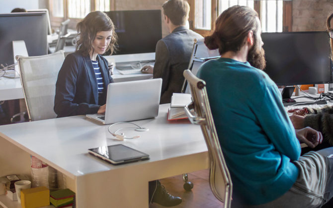 workspace area with people sitting and working, using a personal loan to start a business