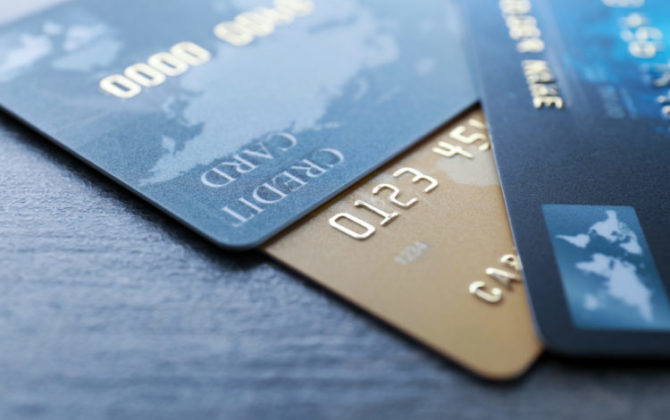 three credit card lying on the table, consolidating debt with a personal loan