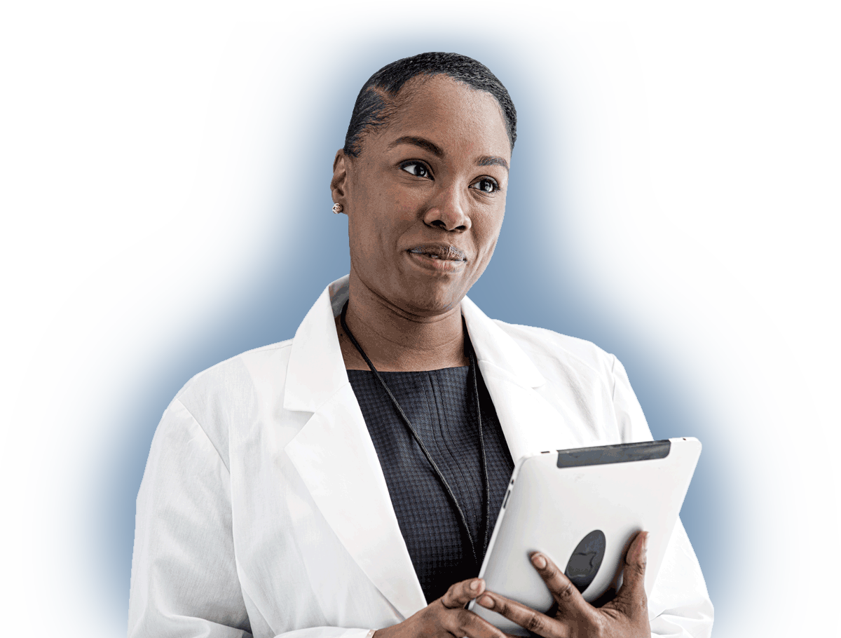 a female doctor wearing a white coat and holding a silver iPad