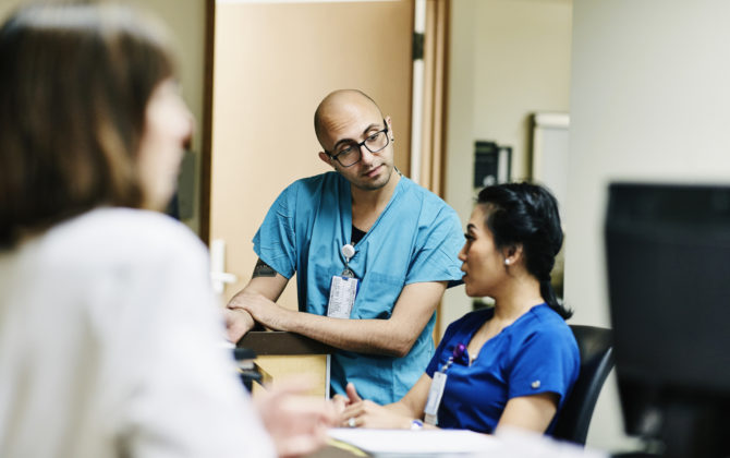 a group of doctors researching about how to open a medical practice