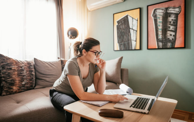 Businesswoman researching about strategies of low-risk investments