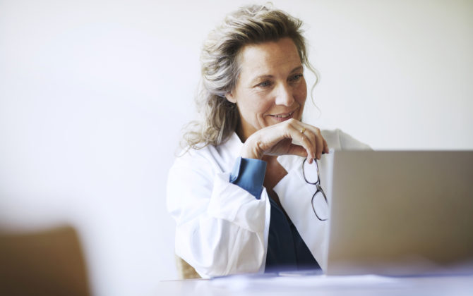 a female doctor reading about the fundamentals of investing
