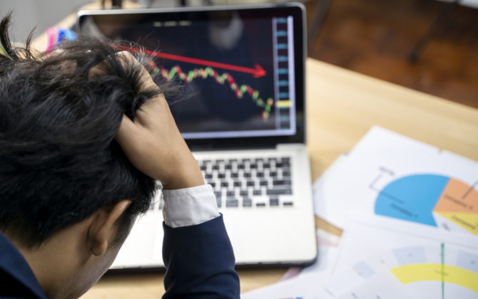 Stock trader tearing out his hair from despair after making common investment mistakes