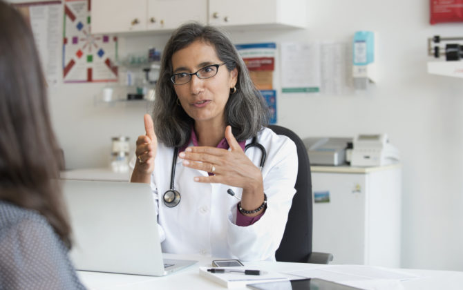 Female doctors discussing reasons why doctors should consider private practice